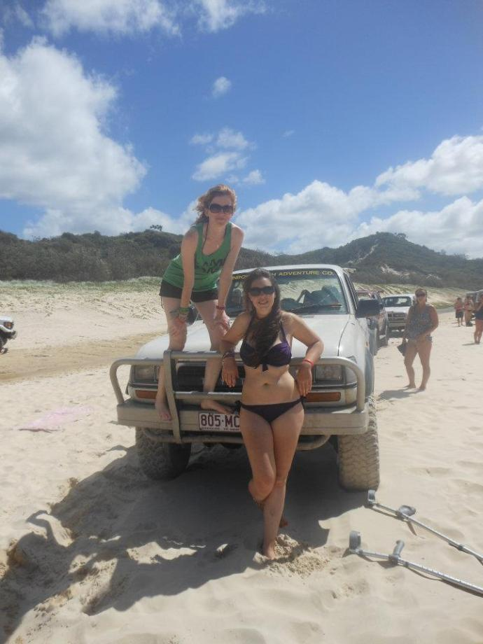 Polly and I on Fraser Island (complete with bad foot and crutches on the floor)