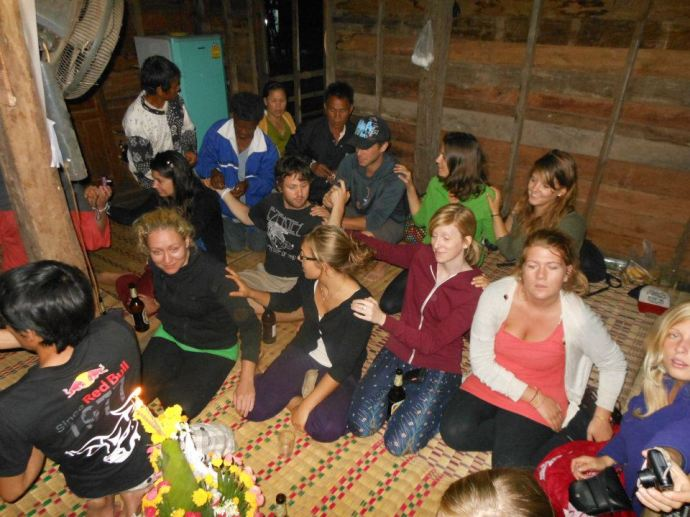 Being part of a Laos success ritual at a homestay in Xe Champhone
