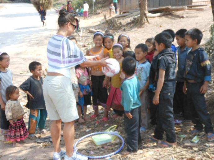 Stopping at Laos villages and giving gifts to the local children