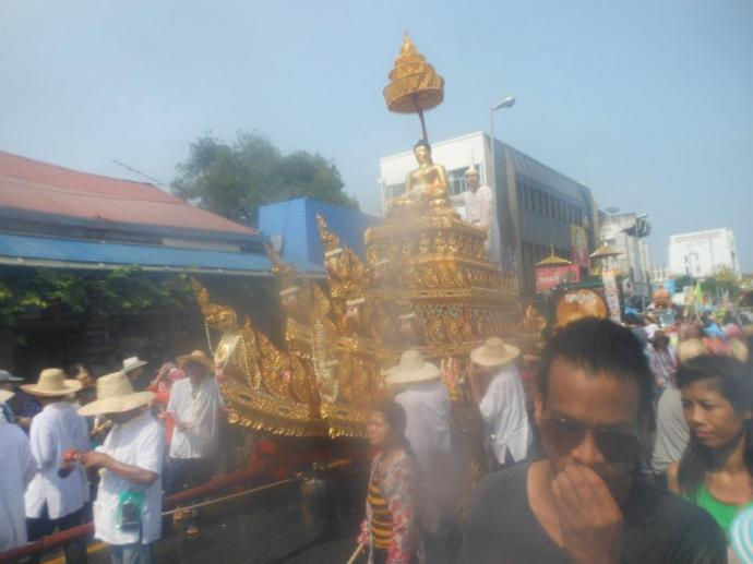One of many buddha statues in the parade